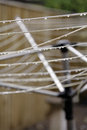Rotary clothes line glistening water drops on a Royalty Free Stock Images