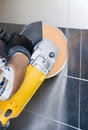 Rotary drill/saw in action Royalty Free Stock Photo