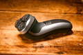 Rotary shaver electric on a wooden table Royalty Free Stock Images