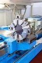 Rotating head in a high precision mechanics plant at CNC lathe Royalty Free Stock Photo