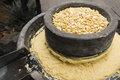 Rotating millstone produce fresh corn mud Royalty Free Stock Photography