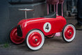 Roter toy race car number four Lizenzfreie Stockfotografie