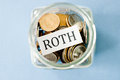 Roth coins in a jar with label on it Royalty Free Stock Photos