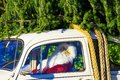 ROTHENBACH, GERMANY - OCTOBER 10. 2018: View on Santa Claus sitting in white VW beetle classic car with fir Christmas tree on roof Royalty Free Stock Photo