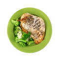 Rotisserie chicken breast broccoli cauliflower on green plate a seasoned golden brown of with and clusters Stock Image