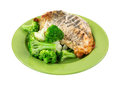 Rotisserie chicken breast vegetables on green plate a seasoned golden brown of with broccoli and cauliflower clusters Stock Images