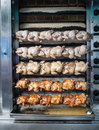 Rotisserie chicken cooking at a market in almeria spain Stock Images