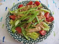 Rotisserie chicken garden salad fresh with lettuce bell pepper tomatoes and snow peas Royalty Free Stock Image