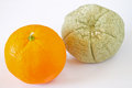 Rotten and fresh orange, focus on rotten Royalty Free Stock Photo