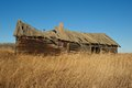 Rotting old house in a grassy fieldwood weathered and broken Stock Photos