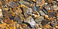 Rough gravel geologic natural background pattern deposit of shiny nrown and grey as a geology nature texture Royalty Free Stock Image
