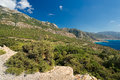 A rough landscape on karpathos greece with a nice view at the ocean Stock Photos