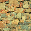 Rough mediterranean stone wall as background instagram effect square image Royalty Free Stock Photo