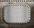 Rough metallic plate over rusty metal background Royalty Free Stock Photo