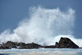 Rough sea a huge wave splashing on rocks in wild indian ocean in stormy weather in south africa Stock Image
