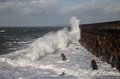 Rough seas waves breaking over holyhead breakwater isle anglesey Royalty Free Stock Photos