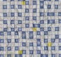 Rough texture of crumpled paper printed with abstract geometric ornament in the form of a blue and white square tiles. Royalty Free Stock Photo