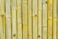Rough yellow bamboo wall texture background Stock Images