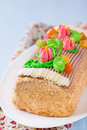 Roulade cake, decorated with colourful buttercream flowers Royalty Free Stock Photo