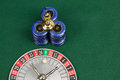 Roulette a with ball and chips on green ground Royalty Free Stock Image
