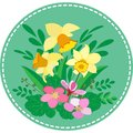 Round-applique with Bush of spring flowers, leaves and blades of grass, and yellow daffodils