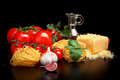 Round balls of pasta with cheese,tomatoes,basil,olive oil on black Royalty Free Stock Photo