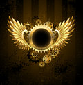 Round banner with steampunk wings brass metal and brass gears on striped background Royalty Free Stock Photos