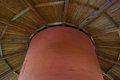 Round barn ceiling inside this is a view of the top of a historic you can see the beautiful spoked beams and the shoot to the hay Stock Image