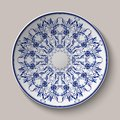 Round blue delicate floral pattern. Chinese style painting on porcelain. The ornament shown on the ceramic platter.