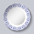 Round blue floral frame. Styling elements based on Chinese or Russian porcelain painting. Ornament shown in a ceramic dish. Royalty Free Stock Photo