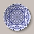 Round blue floral ornament Chinese style painting on porcelain. Pattern shown on the ceramic platter. Royalty Free Stock Photo