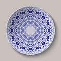 Round blue floral ornament Gzhel style. Pattern shown on the ceramic plate.