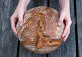 Round bread in chidrens hand Royalty Free Stock Photo