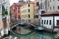 Round bridge over the canal venice italy grand and historic tenements Royalty Free Stock Images