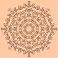 Round brown ornate pattern on beige background
