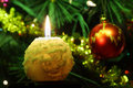 Round candle and Christmas tree ornaments Royalty Free Stock Photo