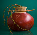 Round ceramic vase with twigs on green Stock Photos