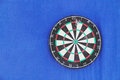 Round dartboard with numbers and with javelins Royalty Free Stock Photo