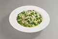 Round dish with boiled rice and peas Royalty Free Stock Photo