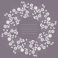 Round frame with flowers and leaves isolated on purple backgroun Royalty Free Stock Photo