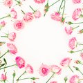 Floral frame made of roses buds on white background. Valentines day composition. Flat lay, Top view