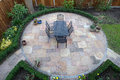 Round garden patio with table and chairs Royalty Free Stock Images