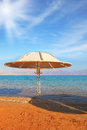Round gazebo leaves deep shadow medical beach on the dead sea israel Stock Photos