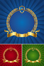 Round golden frame with ribbon and wreath Stock Photo