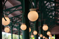 Round lamps yellow in a station with a green metallic structure Royalty Free Stock Image