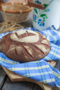 Round loaf of home made bread made from rye whole wheat flour a and sourdough in rystic style selective focus Royalty Free Stock Photos