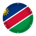 Round metallic flag of Namibia with screw holes