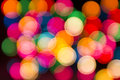 Round multicolor bokeh on a black background colorful glowing circles dark Stock Photography