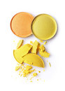 Round orange and yellow crashed eyeshadow for makeup as sample of cosmetics product