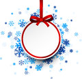 Round paper christmas ball on blue snowflakes. Royalty Free Stock Photo